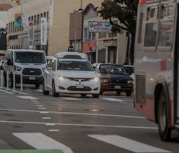 Waymo's autonomous van driving on a street in San Francisco.