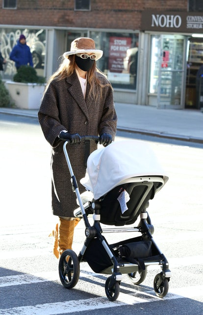 Gigi Hadid goes for a walk with her baby and a friend on January 10th, 2021 in New York City.