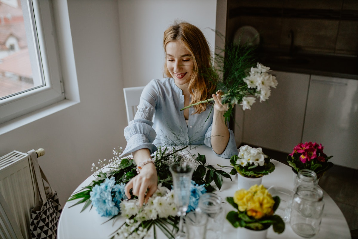A single woman puts together flower bouquets on Valentine's Day during a pandemic.