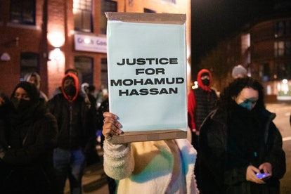 A person holds a sign at the protest for Mohamud Hassan.