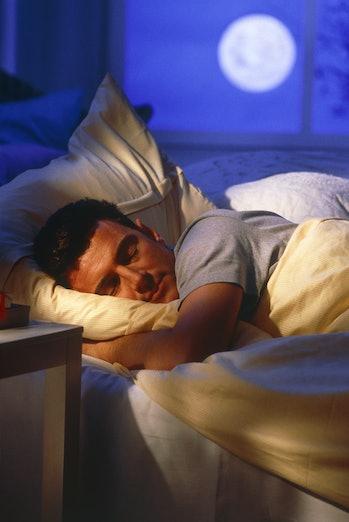 man sleeping with full moon