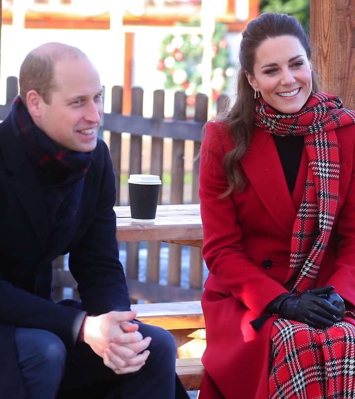 Kate Middleton and Prince William are smiling.