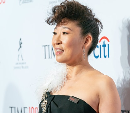 Actress Sandra Oh styles her curly bangs in an edgy mohawk updo