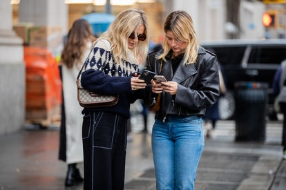 Two street style stars look at their iPhones