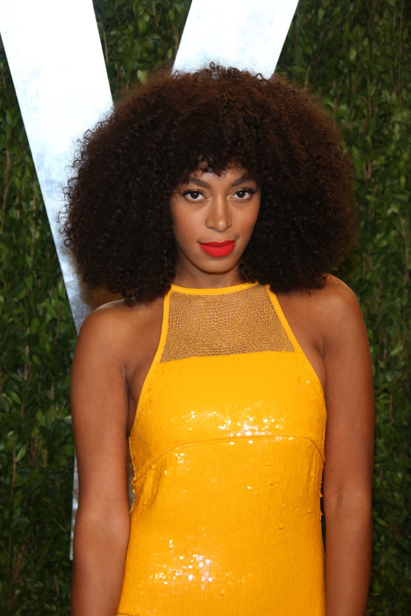 Solange Knowles wears her curly hair with bangs.