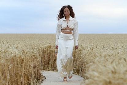 Model walks down Jacquemus runway wearing white