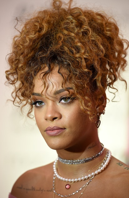 Rihanna rocks curly bangs with this pineapple ponytail