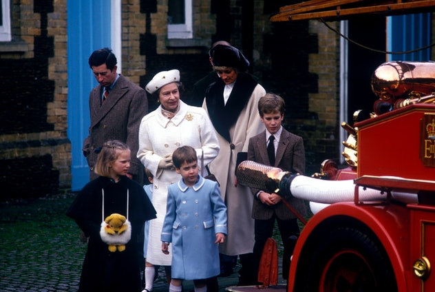 Queen Elizabeth inspects a fire engine with Princess Diana and grandchildren, 1988.
