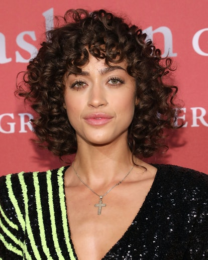 Model Alanna Arrington is a master of styling cute curly bangs