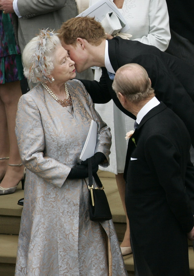 Prince Harry kisses his grandmother in 2008.