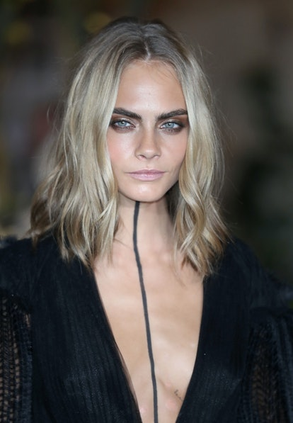 Cara Delevingne's ashy blonde is a 2021 spring hair trend.