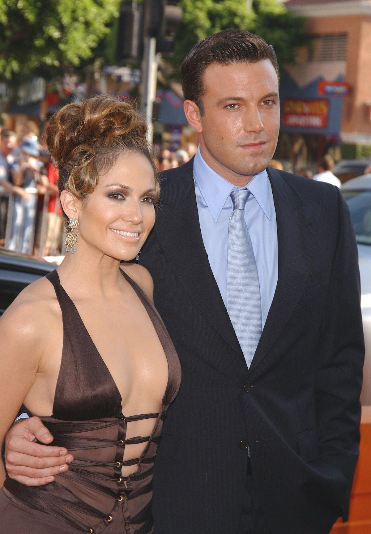 Jennifer Lopez and ex Ben Affleck attend an event.