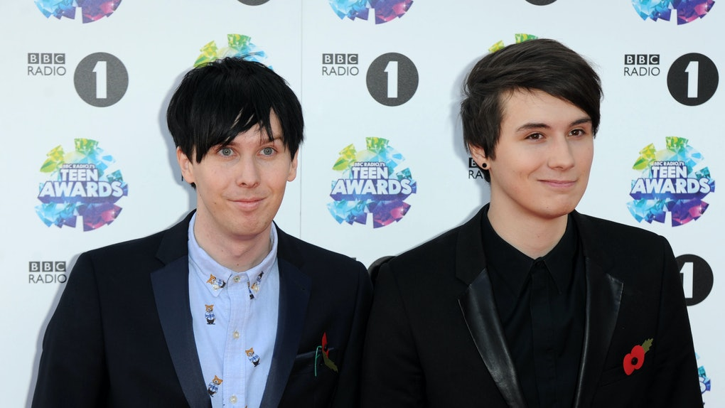 YouTubers Phil Lester and Dan Howell wear black suits on the Teen Awards red carpet.