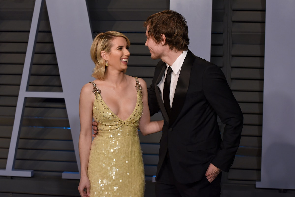 Emma Roberts and Evan Peters attend the Vanity Fair Oscars party.