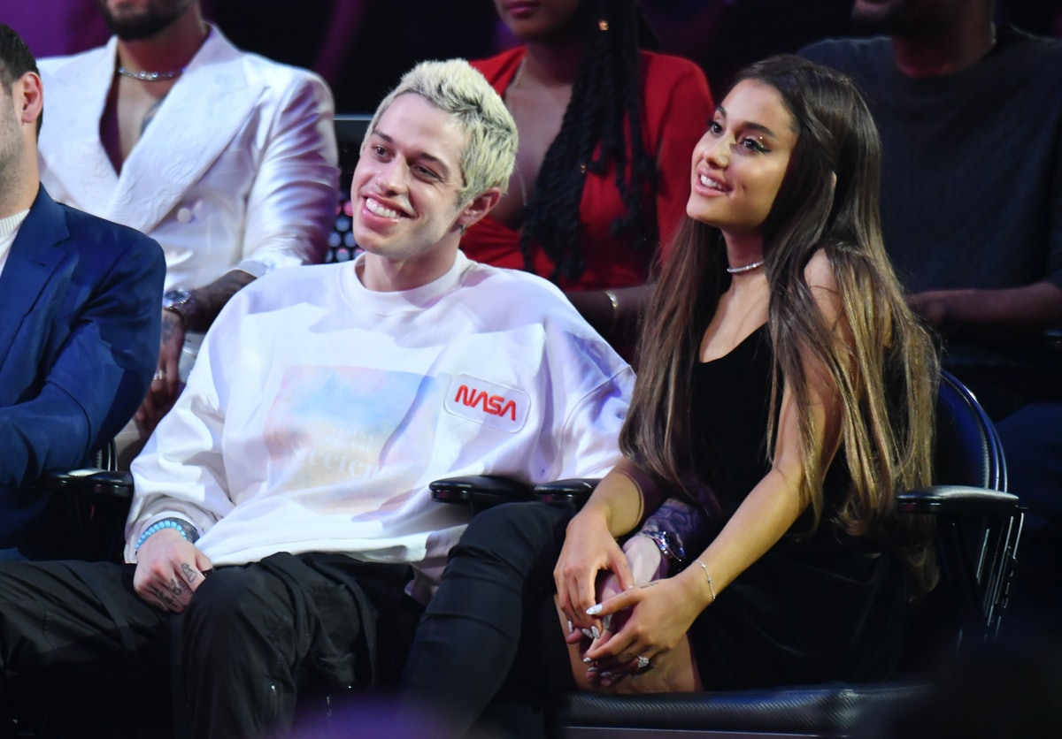 Pete Davidson and Ariana Grande attend a sporting event.