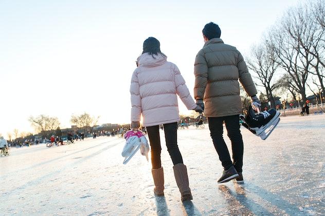 couple walking with ice skates
