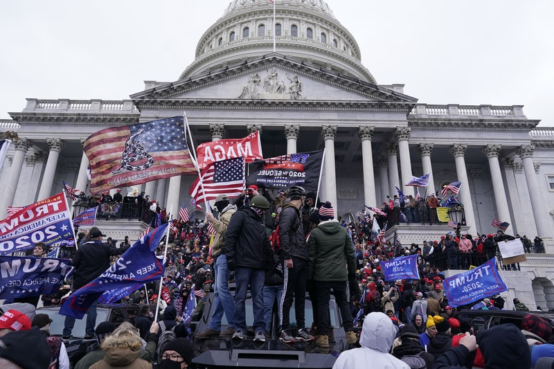 MAGA supporters attack the U.S. capitol building. Photo via Getty Images