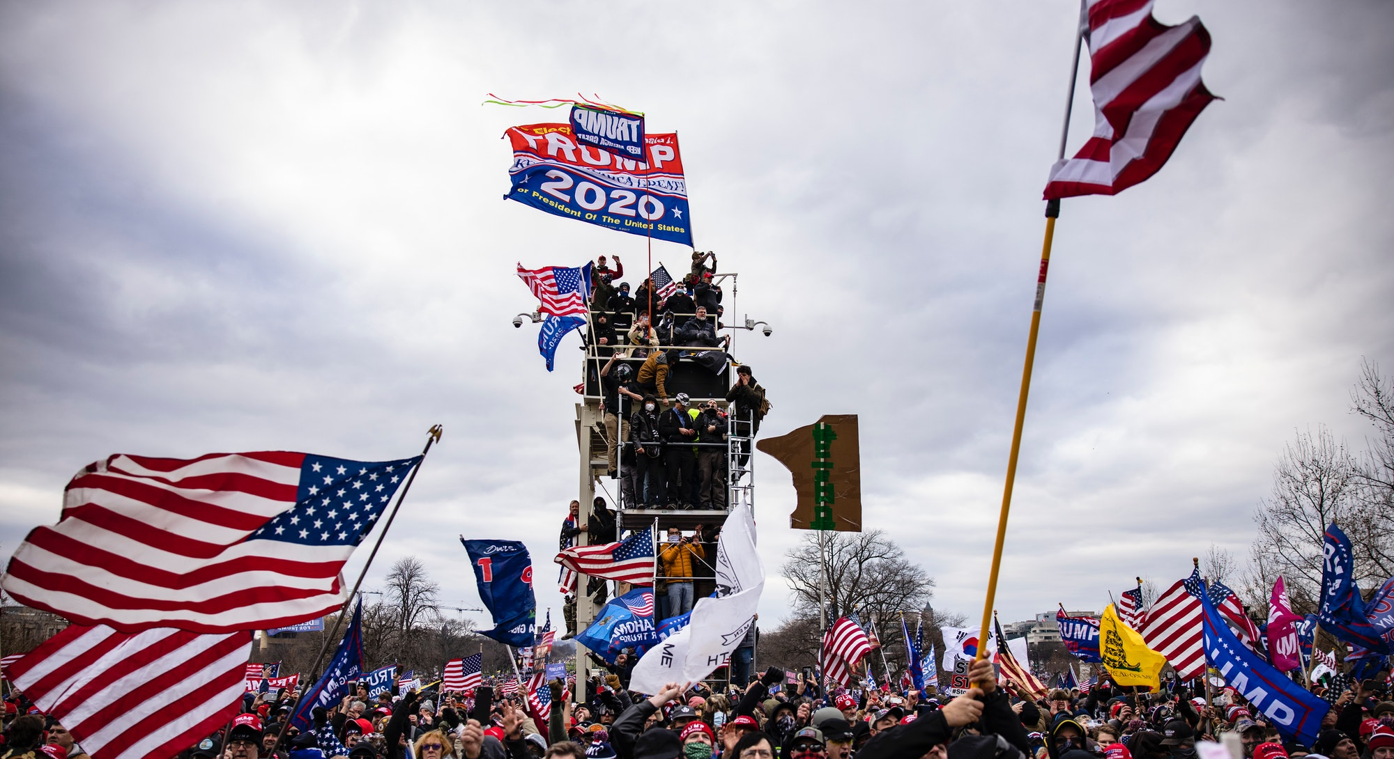 Rioters hold up a trump 2020 flag. Photos of Wednesday Jan 6 Capitol Building insurrection.