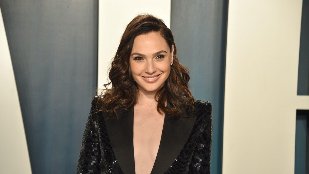 Gal Gadot wears a sequined suit on the red carpet.