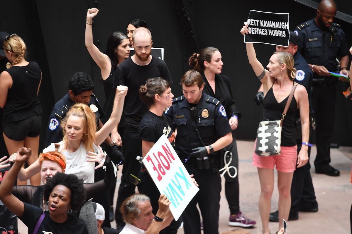 Demonstrators oppose Justice Brett Kavanaugh's Supreme Court nomination on Oct. 4, 2018.
