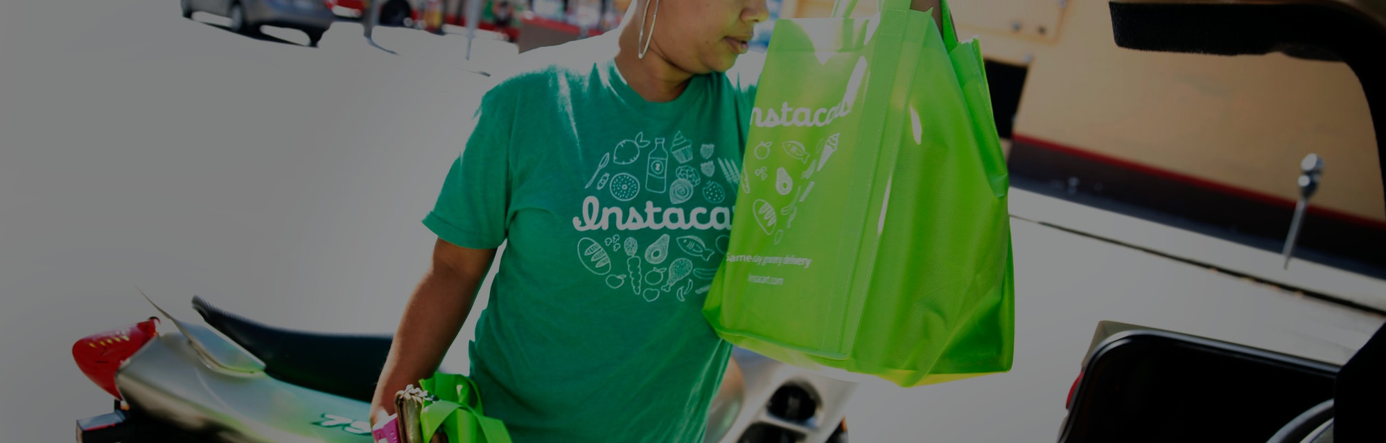 Instacart personal shopper, Tammara Dozier, places a customer's order into her car for delivery on T...