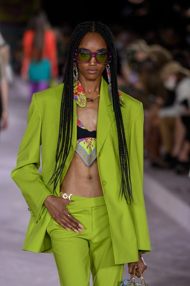 MILAN, ITALY - SEPTEMBER 24: A model walks the runway during the Versace fashion show on the  third ...