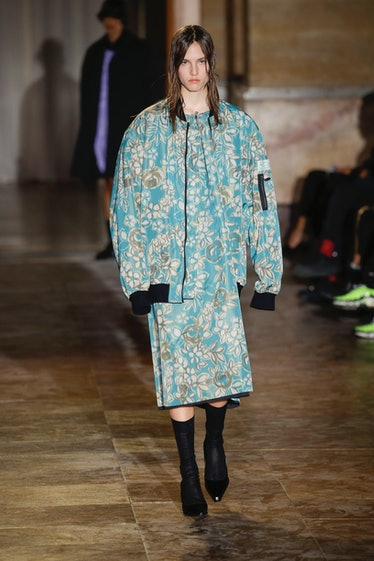 PARIS, FRANCE - SEPTEMBER 30: A model walks the runway during the Raf Simons Ready to Wear Spring/Su...