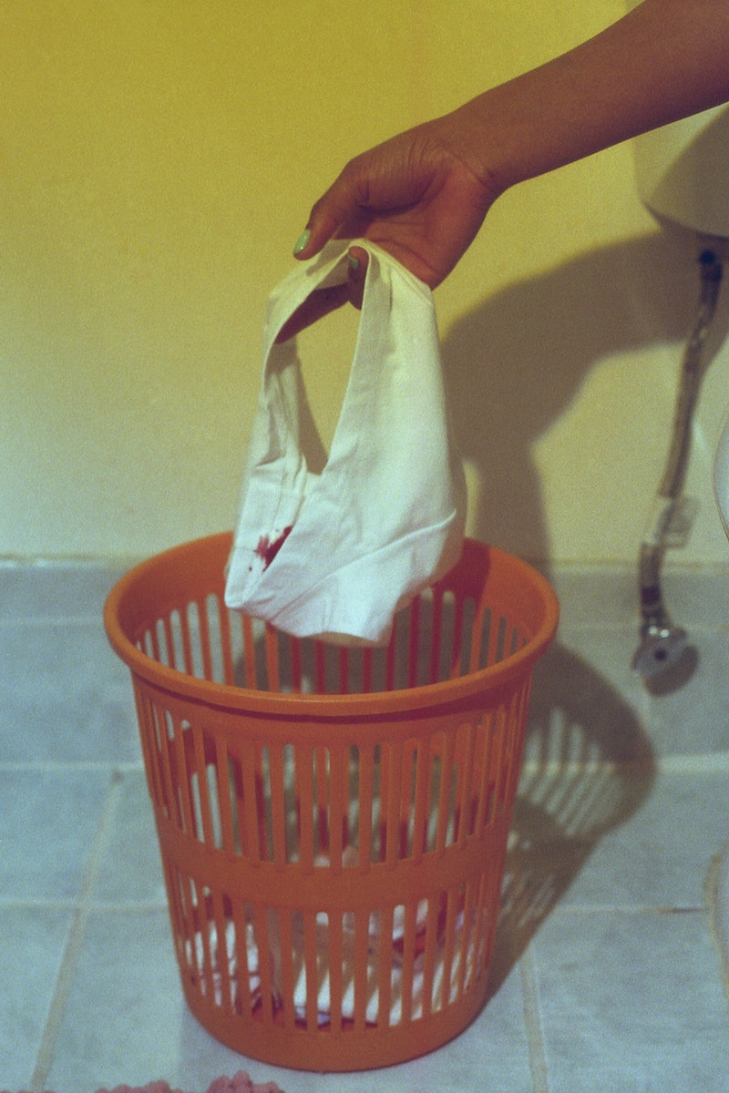 A woman puts stained underwear in the wastebin. How often to change tampon? An OB-GYN explains how o...