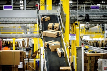 EASTVALE, CA - AUGUST 31: Packages move along a conveyor at Amazon fulfillment center in Eastvale on...