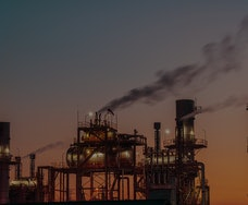 Industrial plants are emitting airborne waste, causing air pollution. pm2.5
