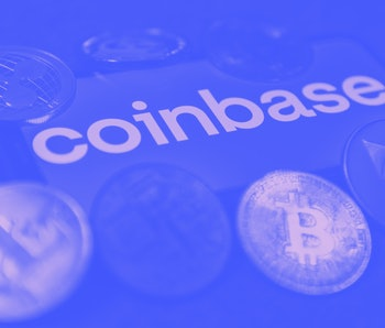 Coinbase logo displayed on a phone screen and representation of cryptocurrencies are seen in this il...