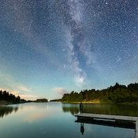 Man Watching the Milky Way and Meteror Shower