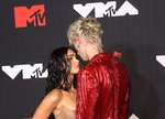 Megan Fox and Machine Gun Kelly on the red carpet. Their first kiss sounds weirdly hot.