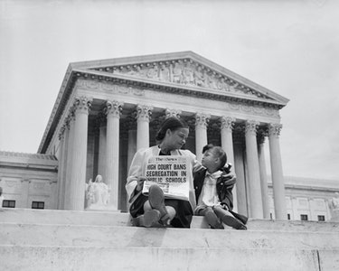Nettie Hunt and her daughter Nickie sit on the steps of the U.S. Supreme Court. Nettie explains to h...