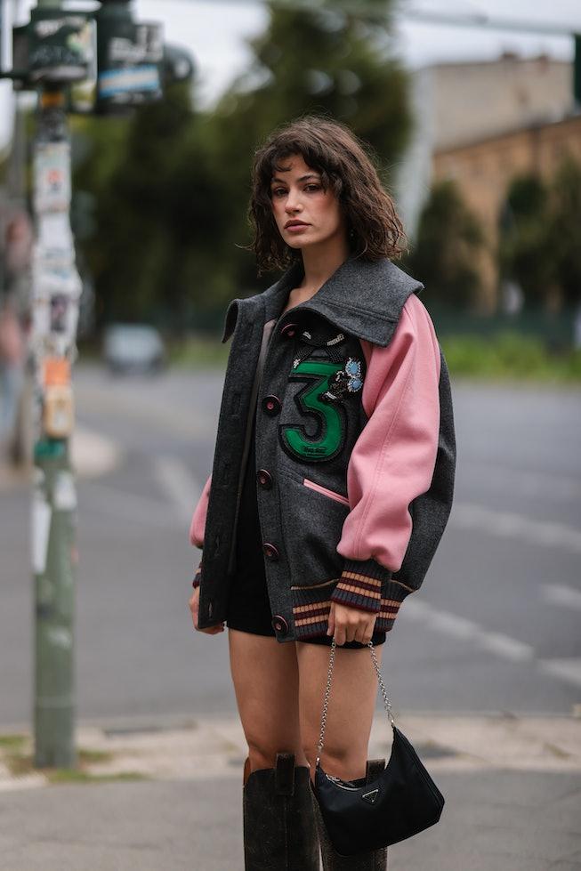 BERLIN, GERMANY - AUGUST 18: Lea Naumann wearing Miu Miu jacket, beige Diesel boots, black Prada bag...