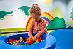 THE HAGUE, NETHERLANDS - JUNE 23: A child is seen playing with Lego during the opening of Legoland t...