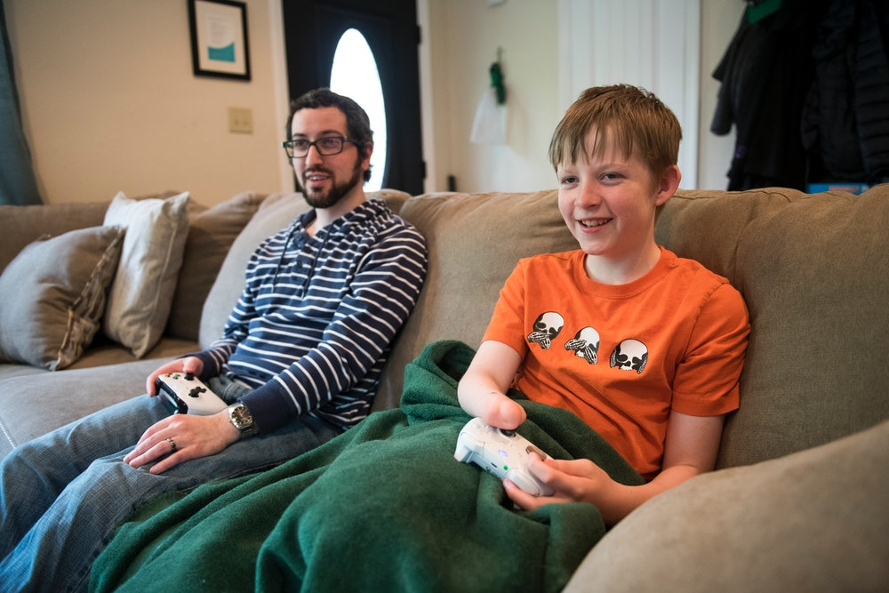 ASHEVILLE, NORTH CAROLINA, UNITED STATES - APRIL 17: Brandon Amico and his step-son Thad, 12, play v...