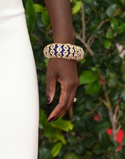 The best neutral nail polish for deep skin is a chocolate brown with berry undertones.
