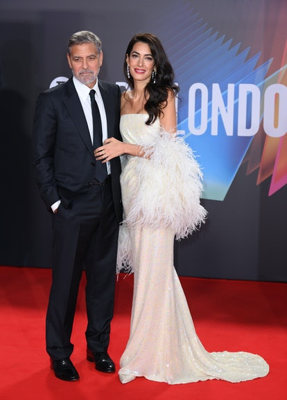 """Amal Clooney wears 16ARGLINGTON sequined gown and feather boa at """"The Tender Bar"""" London premiere on..."""