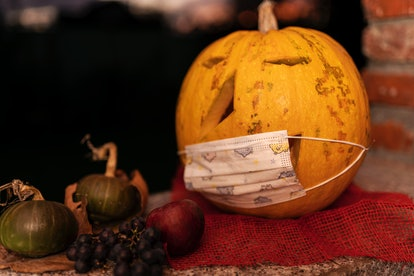For COVID safety this Halloween, a pumpkin wears a medical-style face mask.