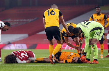 Arsenal's Brazilian defender David Luiz (L) and Wolverhampton Wanderers' Mexican striker Raul Jimene...