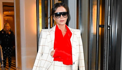 Victoria Beckham wearing a colorful red blouse.
