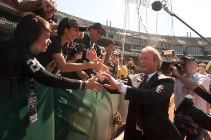 Former Oakland Raiders head coach Jon Gruden, right, now an ESPN broadcaster, greets denizens of the...