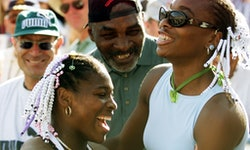 INDIAN WELLS, UNITED STATES:  Serena Williams (L) of the US celebrates her Evert Cup final victory o...