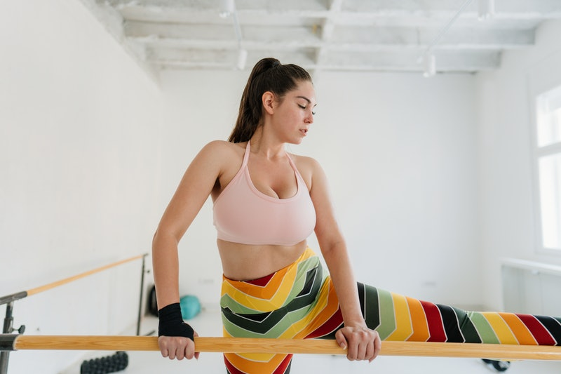 The differences between Pilates vs. barre workouts, explained by trainers.
