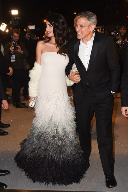 Amal Clooney wears feathered Versace gown while attending the Cesar Dinner with George Clooney on Fe...