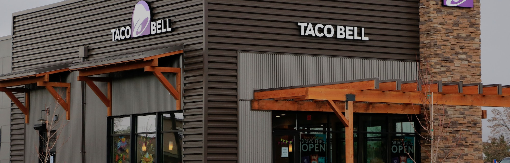 Taco Bell fast food restaurant showing logo on outside walls, northern Idaho. (Photo by: Don & Melin...