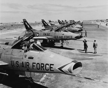 F-100 Super Sabre jet fighters of the US 49th Tactical Fighter Wing in a flight line at Wheelus Air ...