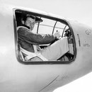 Captain Charles E Yeager is in the cockpit of the Bell X-1 supersonic research aircraft, Muroc Army ...