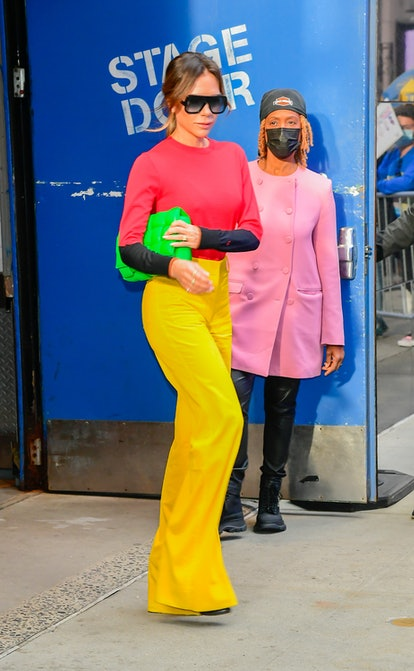 Victoria Beckham wearing a brightly colored outfit in New York City.